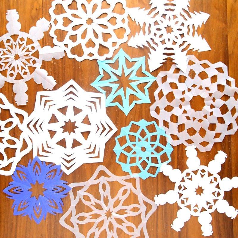 Schneeflocken basteln Papier Muster ausschneiden