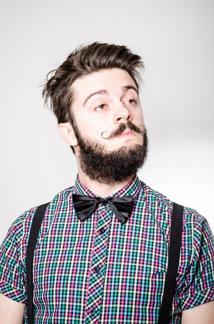 Hipster Frisur zerzaust kurt Schnurrbart Mann