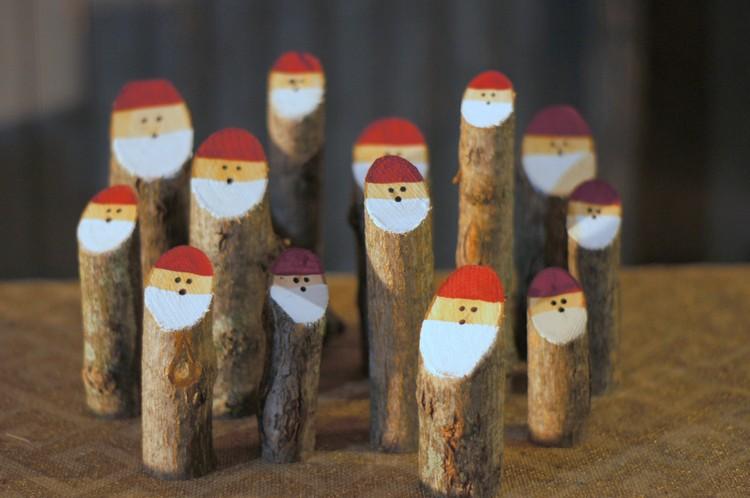 Weihnachtsmann basteln Baumstämme dekorieren