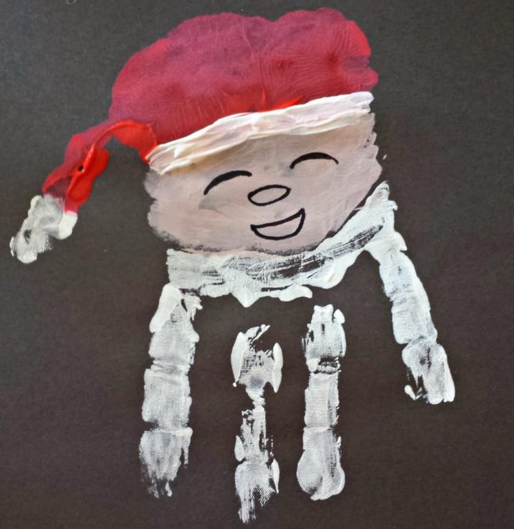 Weihnachtsmann basteln Handabdruck