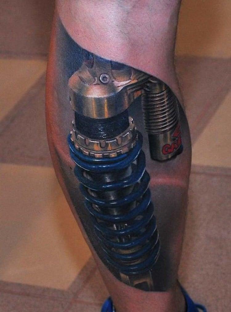 coole Tattoos für Männer Biomechanik Wade