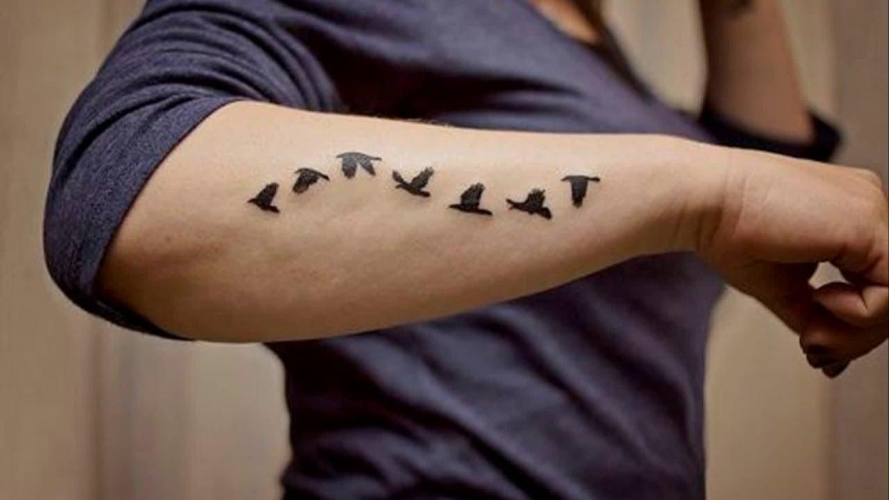 Tattoo Arm Mann dezent Vögel