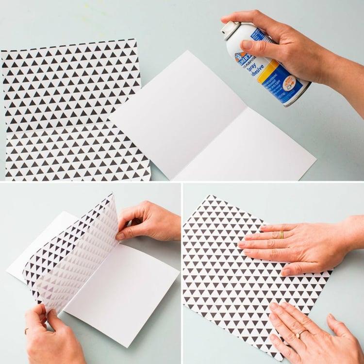 zwei Papierschichten aneinander kleben