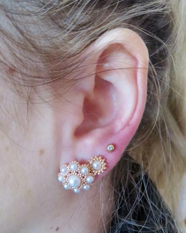 Piercing Ohrläppchen drei Löcher