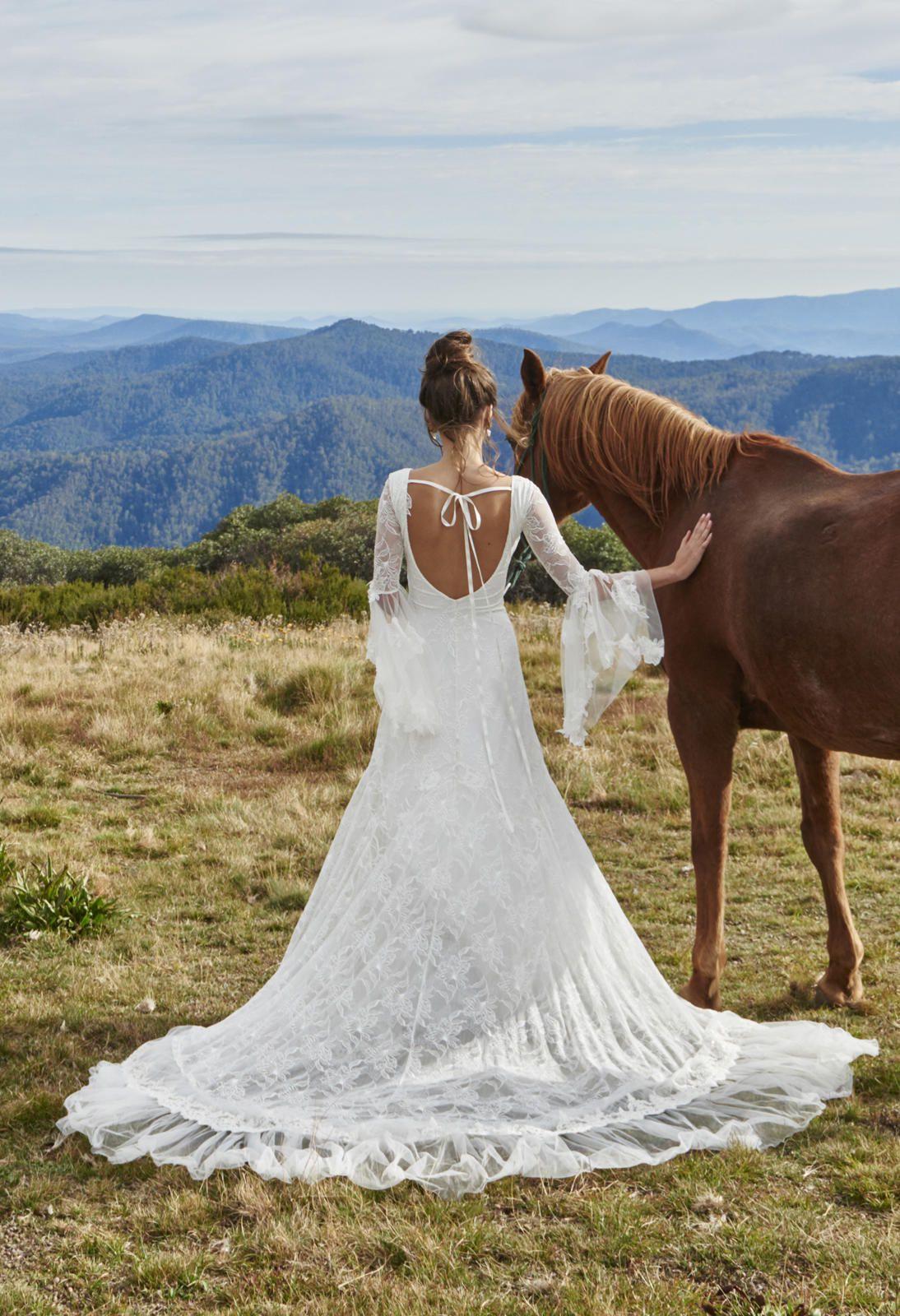 Hochzeitskleid rückenfrei Saum lang echt romantisch