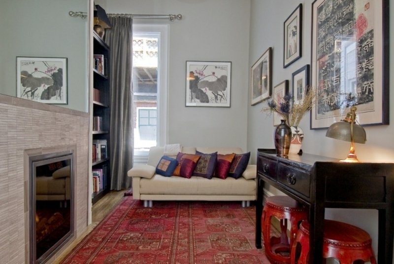 Perserteppich groß rot Wohnzimmer mit Kamin