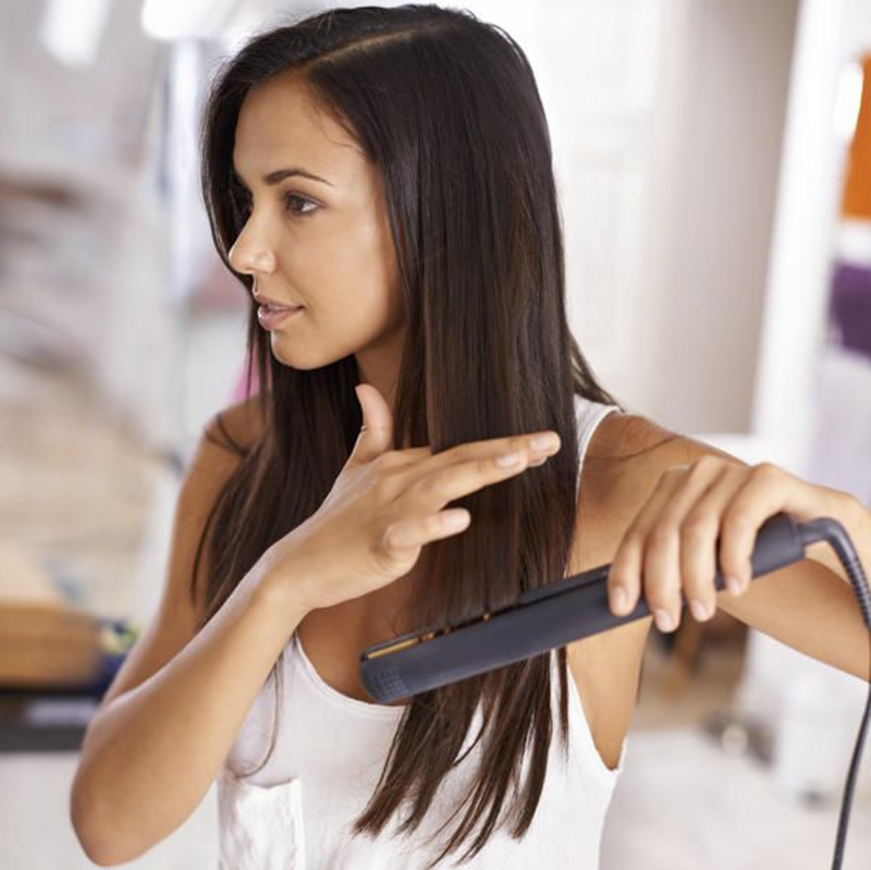 Haarglätter verwenden Hitze das Haarstruktur beschädigen