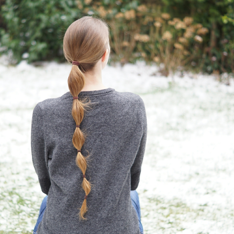 sich einen Keulenzopf machen lange Haare