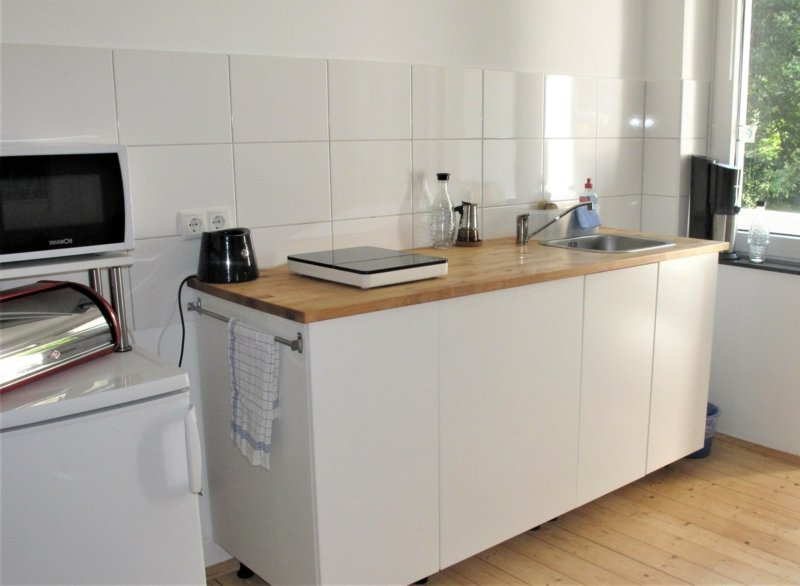Kochinsel modern weiße Kücheneinrichtung