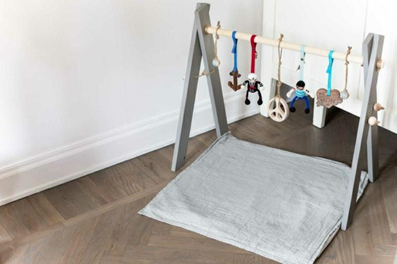 Spielbogen machen Spielzeuge aufhängen