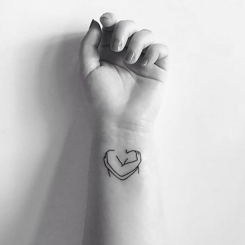 Tattoo dezent Herz Handgelenk