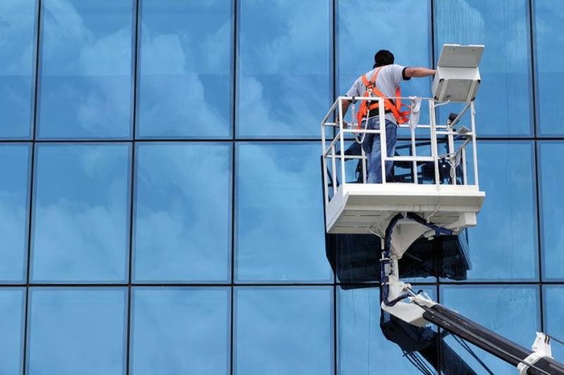 Fenster putzen mit Klarspüler