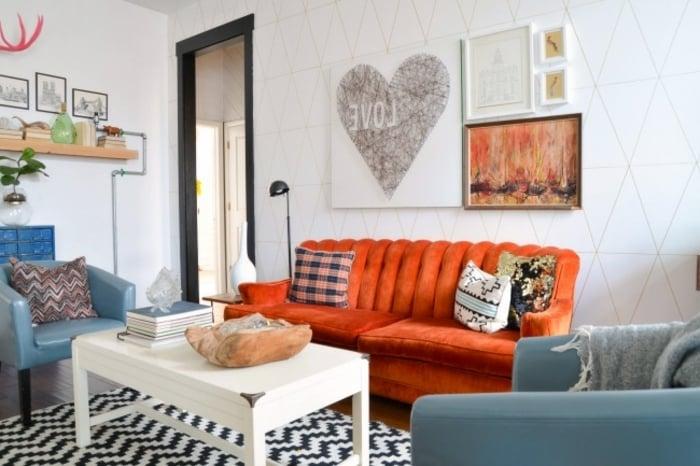 Wohnzimmer oranges Sofa Teppich Zebra Muster
